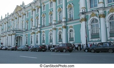 Tourists turn in the Winter Palace in St. Petersburg,...