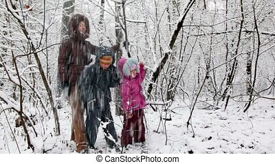 Mother with children in snow forest - Mother with two...