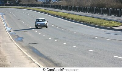 Cars are on highway in sunny day in Moscow, Russia.