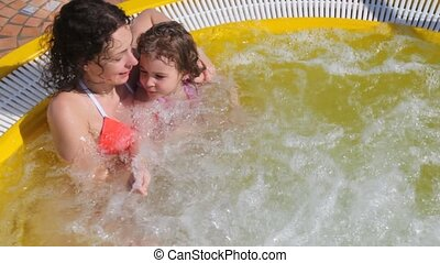 woman and girl in hot whirlpool on deck of ship - woman and...