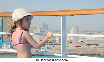 girl stands on deck of cruise ship - little girl stands on...