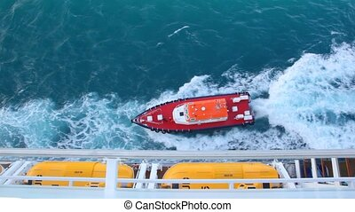 cutter sailing to cruise ship in sea, top view