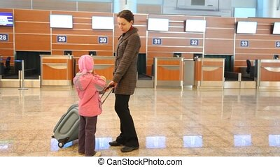 woman and girl at airport