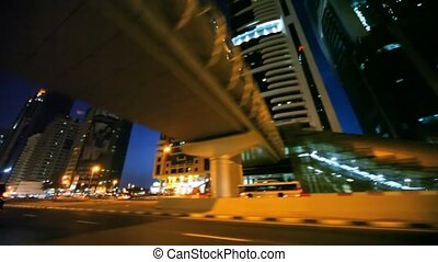 Night Sheikh Zayed road, view through window of moving car in Dubai, UAE.