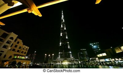 Burj Dubai skyscraper and other buildings at night time in...