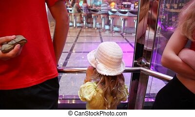 girl with parents in elevator in cruise ship - little girl...