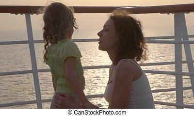 mother and girl on deck of cruise ship