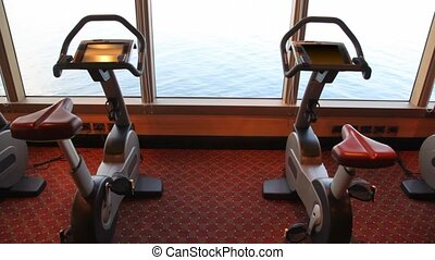exercise bicycles in gym of cruise ship - empty exercise...