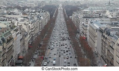 The Champs Elysees and big wheel in Paris, view from...