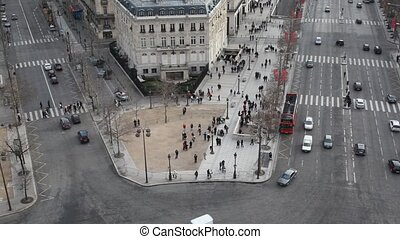 cars and pedestrians on street of Paris, view from Triumphal...