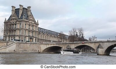 bridge Pont Royal and Louvre in Paris, view from Seine river...