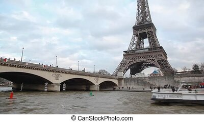 Eiffel Tower and bridge over the Seine river, Paris, France....