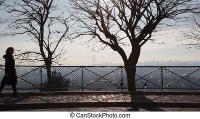 woman walks on Montmartre hill in Paris, France