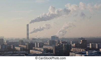 thermal power station in big city smokes in sky