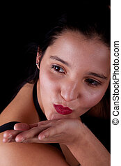 young and beautiful woman to throw a kiss, isolated on black, studio shot