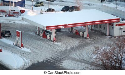 in winter city cars refuel at petrol station - in the winter...