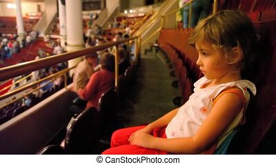 sad girl sits in circus before performance - little sad girl...