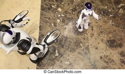 two kids plays with radiocontrol toy robots in shop - two...