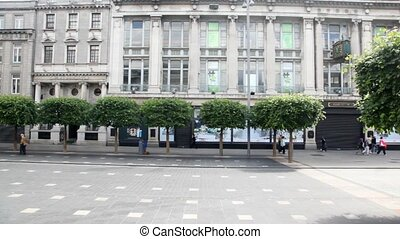 View from bus going through street in Dublin, Ireland. -...
