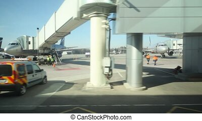 view on airport through window of moving bus in Moscow,...