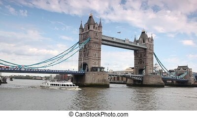 Excursion boat slowly going under magnificent Tower Bridge...