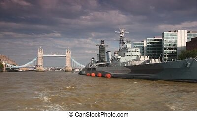 View from excursion boat going near cruiser-museum HMS Belfast
