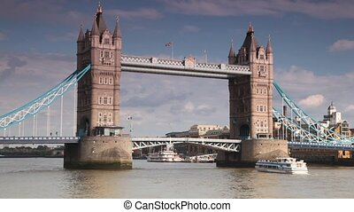 Excursion boat slowly going under great Tower Bridge on...