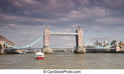 View from boat going near magnificent Tower Bridge on cloudy...