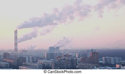 municipal thermal power station in city smokes in sky -...