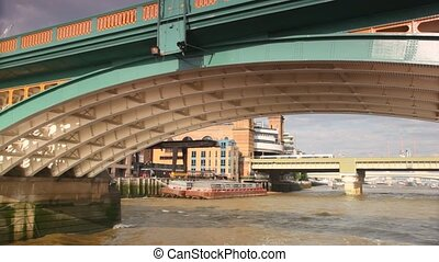 View from excursion boat going slowly under bridge across River Thames
