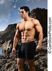 Bodybuilder at the beach