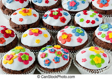 Cupcakes - tilted plate of cupcake with colorful sprinkles
