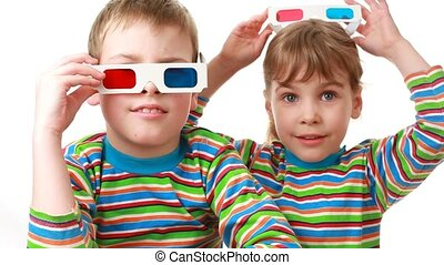 boy and girl sit in anaglyph glasses for viewing stereo images