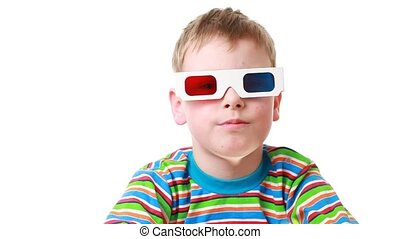 boy sits in anaglyph glasses for viewing stereo images