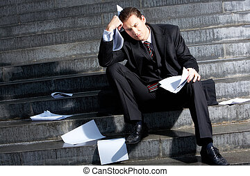 Sad man - Photo of sad businessman sitting on the stairs of...