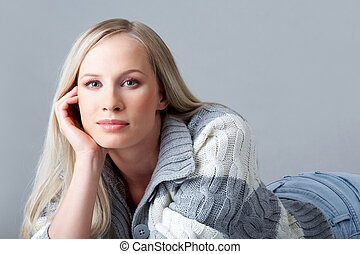 Charming girl - Portrait of blond female in woolen cardigan...