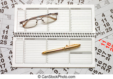 Sheets of a calendar and a notebook