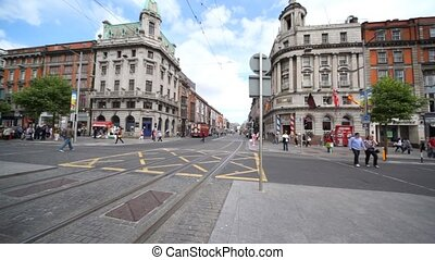 Panoramic view of O'Connell Street and marble statue of John...
