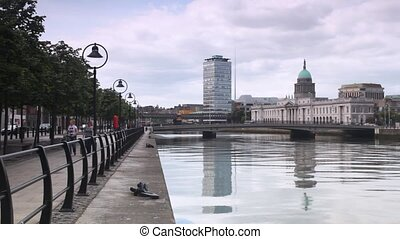 Calm Liffey River and magnificent Custom House in centre of...