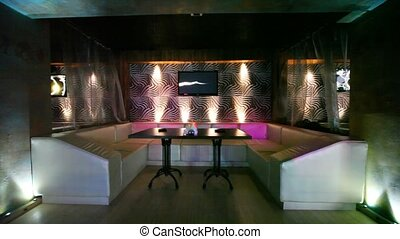 lounge zone in some nightclub with one table and leather...