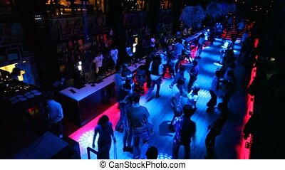 View from about on people dancing and relaxing in nightclub