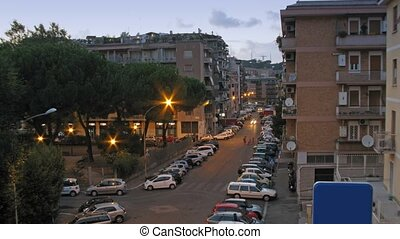 Heavy vehicle traffic at some street of Rome at night