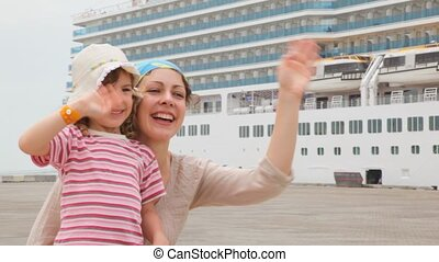 woman and little girl smiling on moorage - young woman and...