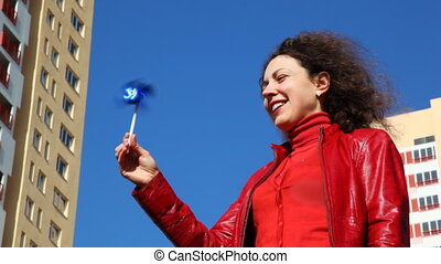 woman holding toy windmill - young woman holding toy...