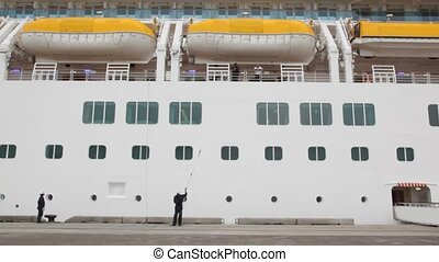 cruise ship is being washed by man - large cruise ship is...