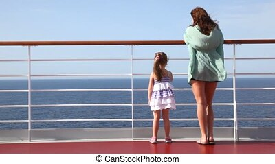 woman and girl standing on deck - woman and little girl...