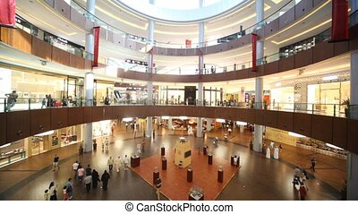 Dubai Mall from inside with shoppers in Dubai, UAE - DUBAI -...