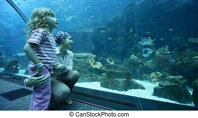 woman and daughter are at the aquarium