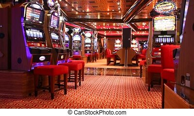 Slot machines in play room in Persian Gulf - PERSIAN GULF -...