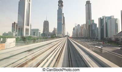 view on city on the right from window of monorail train -...